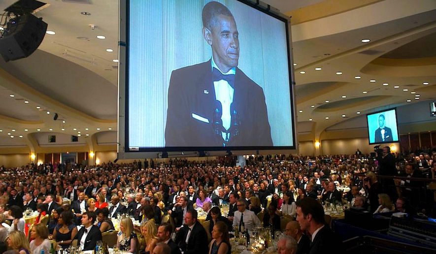 Then-President Barack Obama commands the Jumbotron above some 2,600 guests at the White House Correspondents' Association dinner. (White House Correspondents Association)