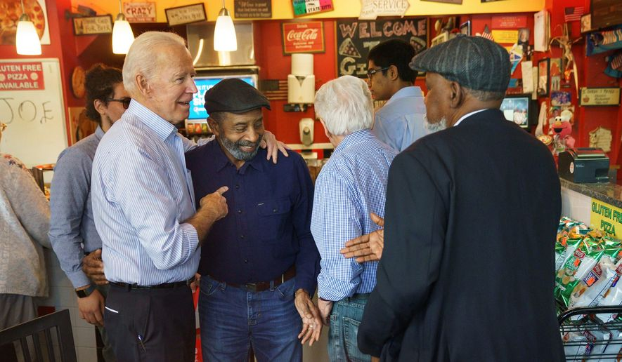 Democratic presidential candidate and former Vice President Joe Biden greets people at Gianni's Pizza, in Wilmington Del., Thursday, April 25, 2019. (Jessica Griffin/The Philadelphia Inquirer via AP)