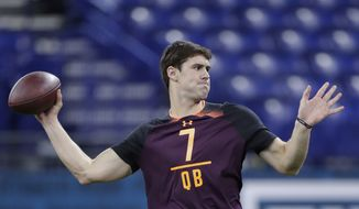 In this March 2, 2019, file photo, Duke quarterback Daniel Jones runs a drill at the NFL football scouting combine in Indianapolis. Jones is a possible pick in the 2019 NFL Draft. (AP Photo/Michael Conroy, File) **FILE**