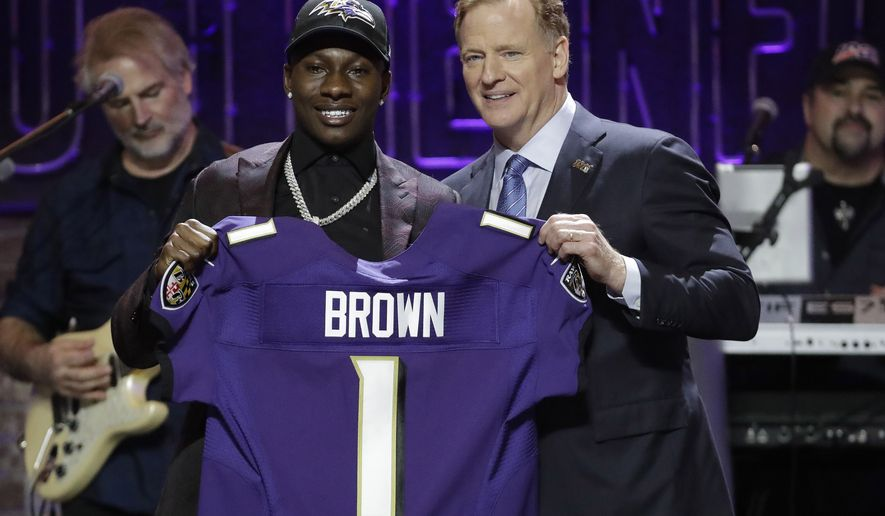 Oklahoma wide receiver Marquise Brown poses with NFL Commissioner Roger Goodell after the Baltimore Ravens Brown selected in the first round at the NFL football draft, Thursday, April 25, 2019, in Nashville, Tenn. (AP Photo/Steve Helber)