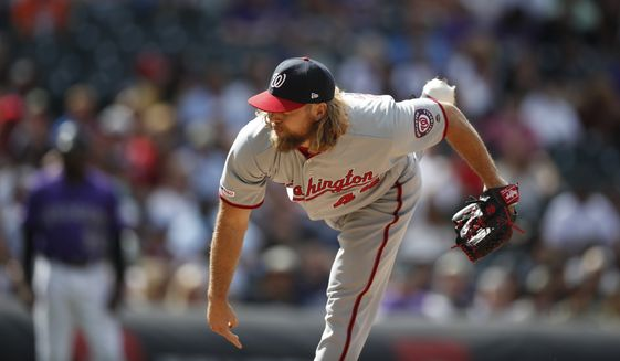 Washington Nationals relief pitcher Trevor Rosenthal (44) in the eighth inning of a baseball game Wednesday, April 24, 2019, in Denver. (AP Photo/David Zalubowski) **FILE**