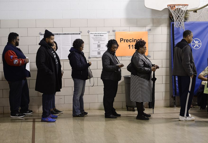 In a Nov. 6, 2018 file photo voters wait in line on election day in Southfield, Mich. A three-judge panel has ruled that Michigan's congressional and legislative maps are unconstitutionally gerrymandered, ordering the state Legislature to redraw at least 34 districts for the 2020 election. The decision issued Thursday, April 25, 2019, also requires special state Senate elections to be held in 2020, instead of 2022 as scheduled. The judges say the maps drawn by Republicans in 2011 violate Democratic voters' constitutional rights.(Clarence Tabb, Jr /Detroit News via AP, File) **FILE**