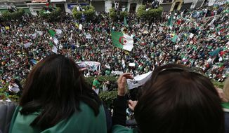 "FILE - In tthis April 5, 2019 file photo, thousands of demonstrators gather for a rally in Algiers. Algerian authorities are leading a ""clean hands"" campaign aimed at rooting out corruption that has caught up top tycoons and former government ministers. Corruption is one of the major complaints of the masses of protesters who helped drive longtime leader Abdelaziz Bouteflika from office earlier this month. (AP Photo/Toufik Doudou, File)"