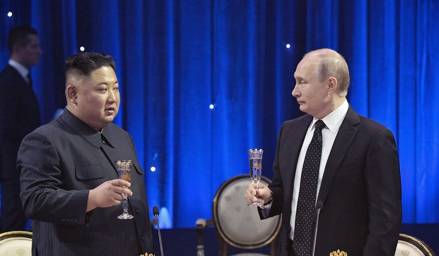 Russian President Vladimir Putin, right, toasts with North Korea's leader Kim Jong-un after their talks in Vladivostok, Russia, Thursday, April 25, 2019. Putin and Kim are set to have one-on-one meeting at the Far Eastern State University on the Russky Island across a bridge from Vladivostok. The meeting will be followed by broader talks involving officials from both sides. (Alexei Nikolsky, Sputnik, Kremlin Pool Photo via AP)