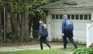 Federal Bureau of Investigation, and  Internal Revenue Service agents search the home of Baltimore Mayor Catherine Pugh in Baltimore, MD., Thursday, April 25, 2019. Agents with the FBI and IRS are gathering evidence inside the two homes of Baltimore Mayor Catherine Pugh and in City Hall. (Jerry Jackson/Baltimore Sun via AP) **FILE**