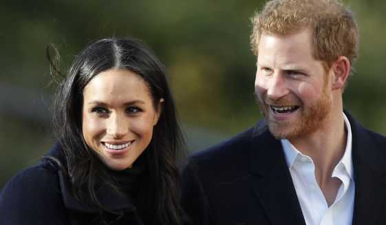 Britain's Prince Harry and Meghan Markle arrive at Nottingham Academy in Nottingham, England, Dec. 1, 2017. (AP Photo/Frank Augstein) ** FILE **