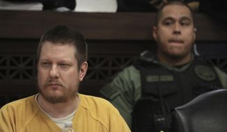 """FILE - In this Jan. 18, 2019, file photo, former Chicago police Officer Jason Van Dyke attends his sentencing hearing at the Leighton Criminal Court Building in Chicago for the 2014 shooting of black teenager Laquan McDonald. In court filings released Wednesday, April 25, 2019, a psychologist's report on Van Dyke says he felt """"shell-shocked"""" in the days that followed the shooting. (Antonio Perez/Chicago Tribune via AP, Pool, File)"""