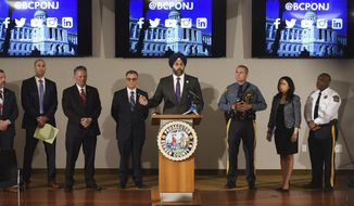 Attorney General Gurbir Grewal announces arrests of adults who officials say used social media messaging and dating apps in an attempt to lure children, during a news conference at Bergen County Prosecutor's Office in Hackensack, N.J., Wednesday, April 24, 2019. Authorities have arrested a police officer, a high school teacher, a minister and about a dozen others in a sting New Jersey officials said Wednesday was aimed at men who tried to set up sexual encounters with people they thought were teenage boys and girls. (Mitsu Yasukawa/The Record via AP)