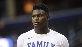 In this March 31, 2019, file photo, Duke forward Zion Williamson warms up before the start of an NCAA men's East Regional final college basketball game against Michigan State, in Washington. (AP Photo/Patrick Semansky) ** FILE **