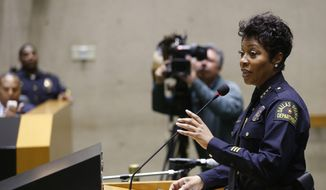 Dallas Police Chief U. Renee Hall answers a question from a Dallas City council member during a meeting at Dallas City Hall in Dallas on Wednesday, April 24, 2019. The Dallas City Council has expanded the powers of the independent panel that oversees city police and hears complaints about officer misconduct. (Vernon Bryant/The Dallas Morning News via AP) ** FILE **