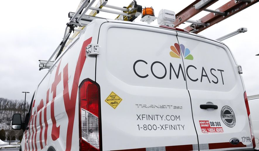 This Jan. 24, 2019, file photo shows a Comcast truck in Pittsburgh. Comcast Corp. reports earns on Thursday, April 25. (AP Photo/Gene J. Puskar, File)