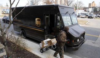 In this Dec. 19, 2018, file photo a UPS driver prepares to deliver packages in Baltimore. (AP Photo/Patrick Semansky, File)