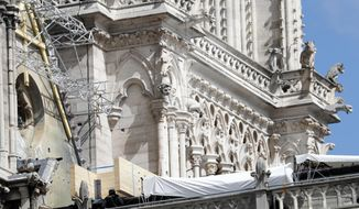 Tarps are pictured on Notre Dame cathedral Wednesday, April 24, 2019 in Paris. Professional mountain climbers were hired to install synthetic, waterproof tarps over the gutted, exposed exterior of Notre Dame Cathedral, as authorities raced to prevent further damage ahead of storms that are rolling in toward Paris. (AP Photo/Thibault Camus)