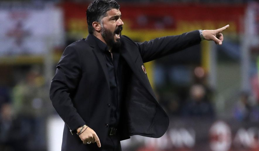 AC Milan coach Gennaro Gattuso gives directions to his players during the Italian Cup, second leg semifinal soccer match between AC Milan and Lazio, at the San Siro stadium, in Milan, Italy, Wednesday, April 24, 2019. (AP Photo/Luca Bruno)