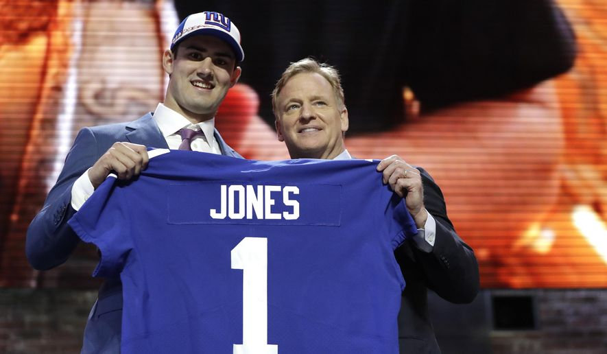 Duke quarterback Daniel Jones poses with NFL Commissioner Roger Goodell after the New York Giants selected Jones in the first round at the NFL football draft, Thursday, April 25, 2019, in Nashville, Tenn. (AP Photo/Mark Humphrey)