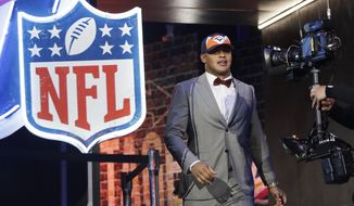 Iowa tight end Noah Fant takes the stage after NFL Commissioner Roger Goodell announced that the Denver Broncos selected Fant in the first round at the NFL football draft, Thursday, April 25, 2019, in Nashville, Tenn. (AP Photo/Mark Humphrey)