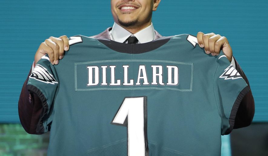 Washington State tackle Andre Dillard shows off his new jersey after the Philadelphia Eagles selected him in the first round at the NFL football draft, Thursday, April 25, 2019, in Nashville, Tenn. (AP Photo/Mark Humphrey)