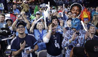Fans watch the action on the main stage during the first round at the NFL football draft, Thursday, April 25, 2019, in Nashville, Tenn. (AP Photo/Mark Humphrey)