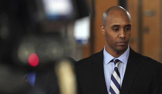 Former Minneapolis police officer Mohamed Noor walks out of the the Hennepin County Government Center Thursday, April 25, 2019, in Minneapolis. Noor took the witness stand in his murder trial for the fatal shooting of Justine Ruszczyk Damond Thursday afternoon, breaking an almost two year public silence to testify about his upbringing and police training. (Brian Peterson/Star Tribune via AP)