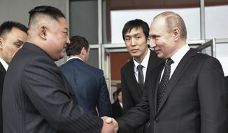 Russian President Vladimir Putin, right, and North Korea's leader Kim Jong-un shake hands after the talks in Vladivostok, Russia, Thursday, April 25, 2019. Russian President Vladimir Putin and North Korean leader Kim Jong Un said Thursday they had good talks about their joint efforts to resolve a standoff over Pyongyang's nuclear program, amid stalled negotiations with the United States. (Alexei Nikolsky, Sputnik, Kremlin Pool Photo via AP)