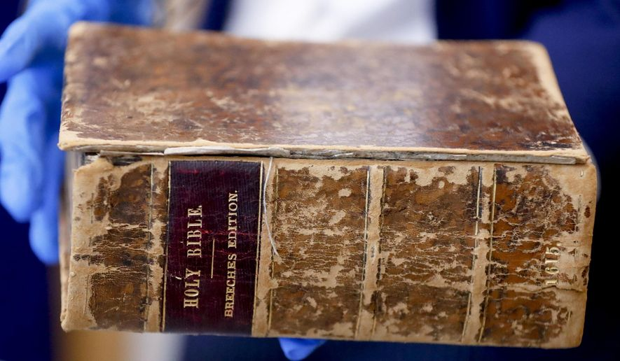 FBI supervisory special agent Shawn Brokos shows the recovered 1615 Breeches Edition Bible during a news conference, Thursday, April 25, 2019, in Pittsburgh. The Bible was stolen from the Carnegie Library in Pittsburgh in the 1990s. It was traced to the American Pilgrim Museum in Leiden, Netherlands. (AP Photo/Keith Srakocic) ** FILE **