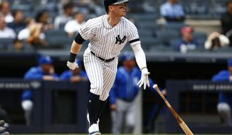 New York Yankees' Clint Frazier watches his three-run home run during the fifth inning of a baseball game against the Kansas City Royals on Sunday, April 21, 2019, in New York. (AP Photo/Adam Hunger)