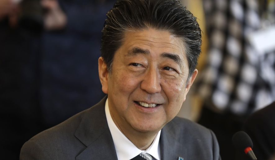 Japan's Prime Minister Shinzo Abe arrives at the V4+Japan summit in Bratislava, Slovakia, Thursday, April 25, 2019. (AP Photo/Petr David Josek)