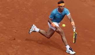 Rafael Nadal of Spain returns the ball to David Ferrer of Spain during his men's singles match at the Barcelona Open Tennis Tournament in Barcelona, Spain, Thursday, April 25, 2019. (AP Photo/Manu Fernandez)