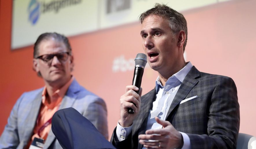 Keith Wachtel, right, CRO and executive vice president of the NHL, speaks as Joe Januszewski, CRO and executive vice president of the Texas Rangers baseball team, listens during a panel discussion talking about sponsorship revenue during the Betting On Sports America conference, Thursday, April 25, 2019, in Secaucus, N.J. (AP Photo/Julio Cortez)