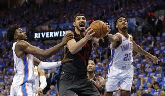 Portland Trail Blazers center Enes Kanter, center, Oklahoma City Thunder forward Jerami Grant, left, and guard Terrance Ferguson, right, compete for a rebound in the second half of Game 4 of an NBA basketball first-round playoff series Sunday, April 21, 2019, in Oklahoma City. Portland won 111-98. (AP Photo/Alonzo Adams) **FILE**