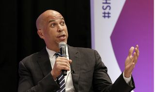 In this April 24, 2019, photo, Democratic presidential candidate Sen. Cory Booker, D-N.J., answers questions during a presidential forum held by She The People on the Texas State University campus in Houston. (AP Photo/Michael Wyke)