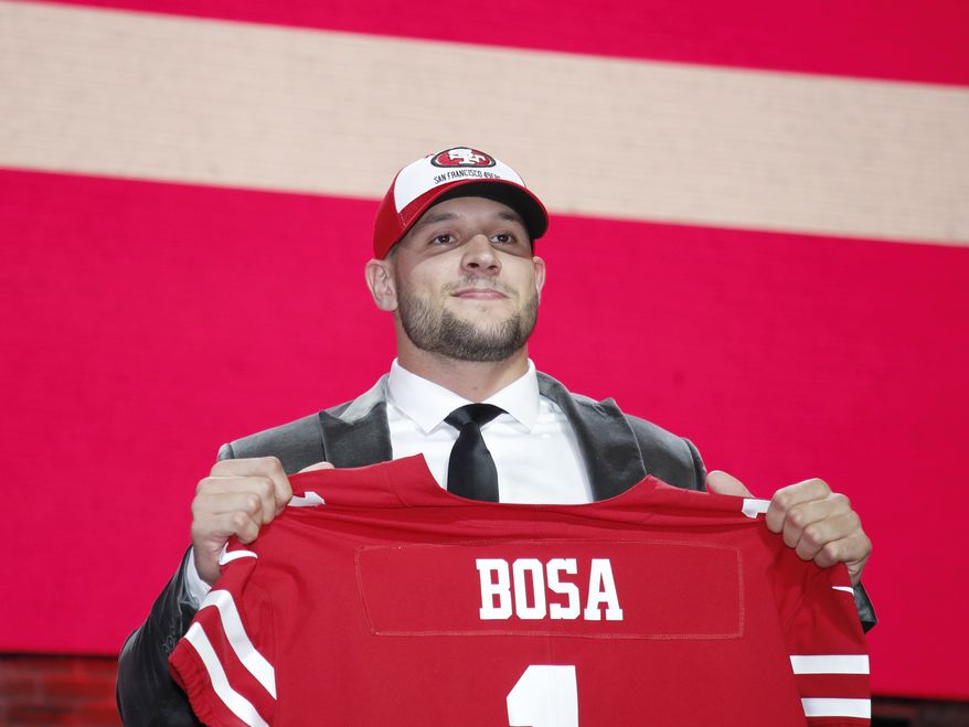 Ohio State defensive end Nick Bosa poses with his new team jersey after the San Francisco 49ers selected Bosa in the first round at the NFL football draft, Thursday, April 25, 2019, in Nashville, Tenn. (Jeff Haynes/AP Images for Panini) **FILE**