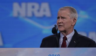 Nation Rifle Association President Col. Oliver North speaks at the National Rifle Association Institute for Legislative Action Leadership Forum in Lucas Oil Stadium in Indianapolis, Friday, April 26, 2019. (AP Photo/Michael Conroy)
