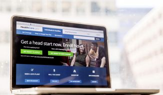 FILE - In this Oct. 6, 2015, file photo, the HealthCare.gov website, where people can buy health insurance, is displayed on a laptop screen in Washington. A new poll finds that Americans are giving Democrats a clear advantage on health care as the 2020 presidential campaign gears up. (AP Photo/Andrew Harnik, File)
