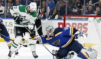 Dallas Stars' Alexander Radulov (47) pressures the net as St. Louis Blues goaltender Jordan Binnington (50) attempts to clear an airborne puck during the first period in Game 1 of an NHL second-round hockey playoff series Thursday, April 25, 2019, in St. Louis. (AP Photo/Jeff Roberson)