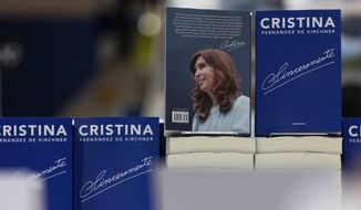 A display of the new book written by Argentina's former president Cristina Fernandez, stands at the Buenos Aires book fair, in Buenos Aires, Argentina, Friday, April 26, 2019. In what many see as a launch of her campaign to return to power, the former President looks set to shake the country's turbulent political landscape with the release of the new book. (AP Photo/Tomas F. Cuesta)