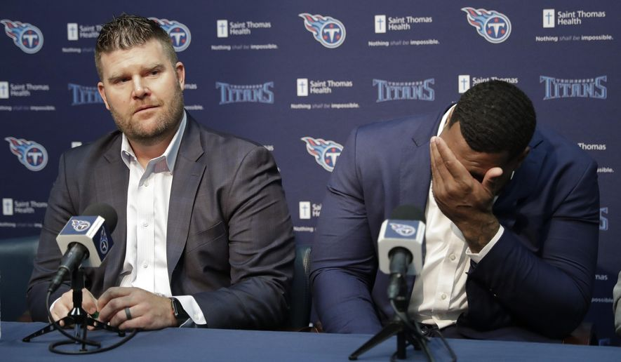 Mississippi State defensive tackle Jeffery Simmons, right, wipes tears as Tennessee Titans general manager Jon Robinson speaks about him during a news conference Friday, April 26, 2019, in Nashville, Tenn. Simmons was selected in the first round of the NFL football draft by the Titans. (AP Photo/Mark Humphrey)