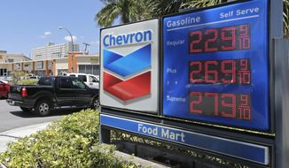 FILE - In this May 15, 2017, file photo, motorists pass a Chevron sign listing gas prices, in Miami Springs, Fla. Chevron Corp. reports financial results on Friday, April 26, 2019. (AP Photo/Alan Diaz, File)