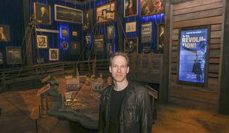 "Hamilton exhibition creative director and designer David Korins, poses for a portrait at the exhibit in Chicago, Thursday, April 25, 2019. Korins is standing in one of 19 rooms that make up a 360-degree immersive experience to accompany ""Hamilton"" the musical. Visitors can follow Alexander Hamilton's life as a trader in St. Croix to his death in a duel with Aaron Burr in 1804. (AP Photo/Teresa Crawford)"