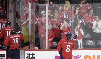 Washington Capitals left wing Alex Ovechkin (8), of Russia, gives away his stick as the team leaves the ice after Game 7 of an NHL hockey first-round playoff series against the Carolina Hurricanes, Wednesday, April 24, 2019, in Washington. The Hurricanes won 4-3 in double overtime. (AP Photo/Nick Wass)