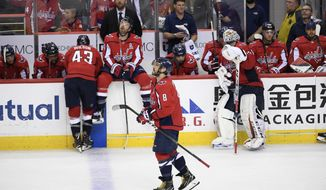 Washington Capitals left wing Alex Ovechkin (8), of Russia, and other members of the Capitals react after losing 4-3 to the Carolina Hurricanes in double overtime of Game 7 of an NHL hockey first-round playoff series, Wednesday, April 24, 2019, in Washington. (AP Photo/Nick Wass)