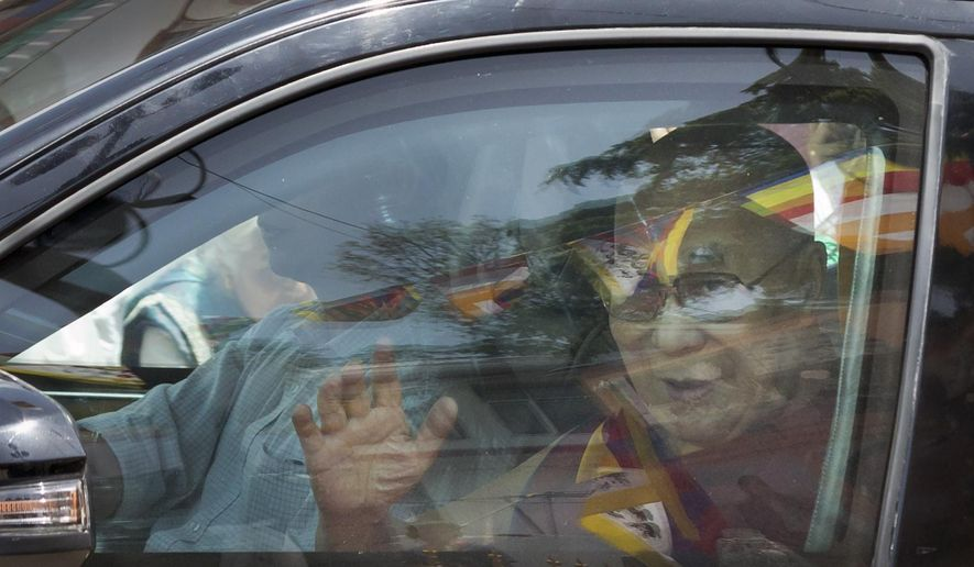 Tibetan spiritual leader the Dalai Lama greets devotees as he arrives in Dharmsala, India, Friday, April 26, 2019. Hundreds of exiled Tibetans lined the streets of Dharmsala carrying ceremonial scarves and incense sticks to welcome the Dalai Lama who returned after a brief stay in a hospital in New Delhi for treatment of a chest infection. (AP Photo/Ashwini Bhatia)