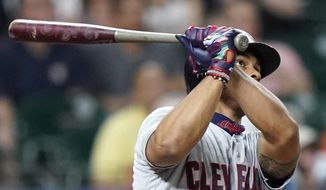 Cleveland Indians' Francisco Lindor watches his home run against the Houston Astros during the third inning of a baseball game Friday, April 26, 2019, in Houston. (AP Photo/David J. Phillip)