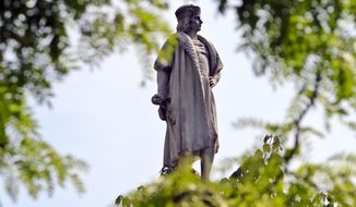 FILE - This Aug. 27, 2017 file photo shows the Christopher Columbus statue at Manhattan's Columbus Circle in New York. Maine Gov. Janet Mills signed a bill on Friday, April 26, 2019, changing Columbus Day to Indigenous People's Day in the state. Vermont is also poised to act on a similar bill as several states have done away with celebrating the explorer in deference to Native Americans, though the federal Columbus Day holiday remains. (AP Photo/Bebeto Matthews, File)
