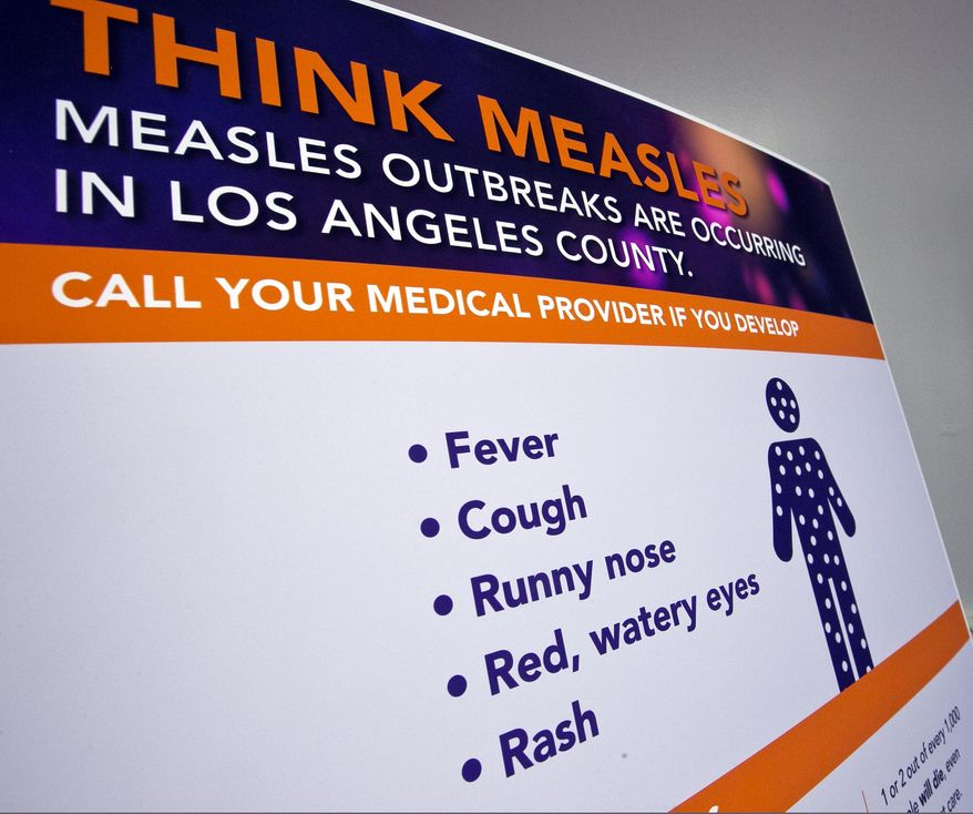 A poster released by Los Angeles County Department of Public Health is seen as experts answer questions regarding the measles response and the quarantine orders in Los Angeles Friday, April 26, 2019. Hundreds of students and staff members at two Los Angeles universities were sent home this week in one of the most sweeping efforts yet by public health authorities to contain the spread of measles in the United States, where cases have reached a 25-year high. (AP Photo/Damian Dovarganes) **FILE**