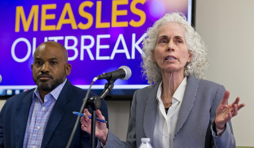 In this file photo, Los Angeles County Department of Public Health experts, Muntu Davis, Health Officer, left, and Director Dr. Barbara Ferrer answer questions regarding the measles response and the quarantine orders during a news conference in Los Angeles Friday, April 26, 2019. (AP Photo/Damian Dovarganes)  **FILE**