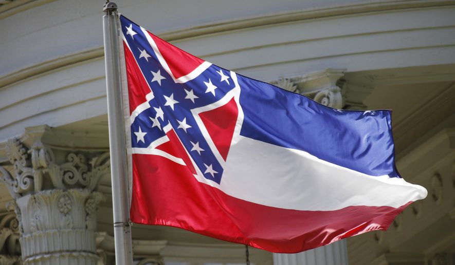 FILE - In this June 23, 2015 file photo, the state flag of Mississippi flies at the Governor's Mansion in Jackson, Miss. On Friday, April 26, 2019, New Jersey Gov. Phil Murphy ordered the Mississippi flag removed from a display of each state's flag at Liberty State Park and replaced by the American flag because it has a confederate emblem on it. Liberty State Park is on the Hudson River and overlooks the Statue of Liberty. (AP Photo/Rogelio V. Solis, File)