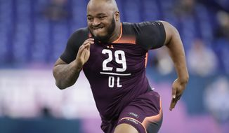 FILE - In this March 1, 2019, file photo, Mississippi State offensive lineman Elgton Jenkins runs a drill at the NFL football scouting combine in Indianapolis. Jenkins is a possible pick in the 2019 NFL Draft. (AP Photo/Michael Conroy, File)