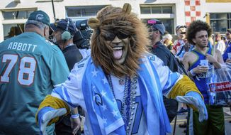 Detroit Lions fan Aaron Latimer from Saginaw, Michigan supports his team during the NFL Draft, Friday, April 26, 2019 in Nashville, Tenn. While it isn't unusual for fans who cheer for the same teams to bond at the NFL Draft, several super fans in Nashville for Friday's second and third rounds have enjoyed getting to know fans of teams they will be rooting against when the season kicks off in the fall. (AP Photo/Jim Diamond)