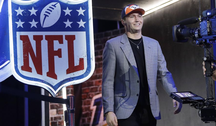 Missouri quarterback Drew Lock enteres the stage after the Denver Broncos selected Lock during the second round of the NFL football draft, Friday, April 26, 2019, in Nashville, Tenn. (AP Photo/Mark Humphrey)
